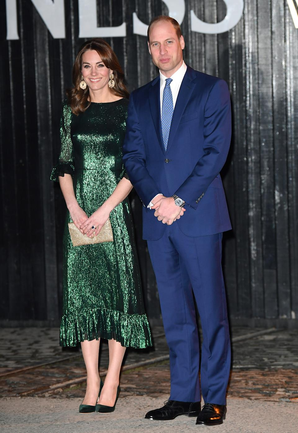 Duchess Catherine wore the Falconetti dress from The Vampire's Wife, which she paired with Manolo Blahnik heels and H&M earrings. (Getty)