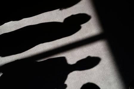 Shadows of people are cast on the carpet of the United Nations Security Council before a meeting about sexual violence in conflict in New York, New York, U.S., April 23, 2019.   REUTERS/Carlo Allegri