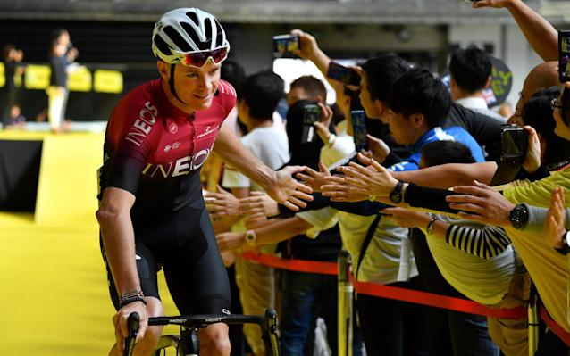 Chris Froome of Team Ineos (L) greets fans after the opening ceremony of the 2019 Tour de France - AFP