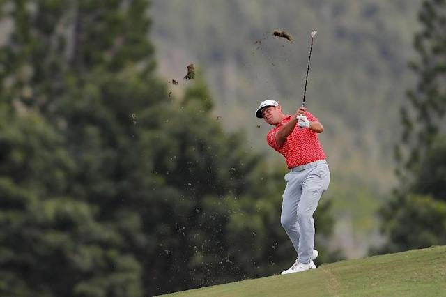 Third-round leader - Gary Woodland plays the 12th hole at Kapalua's Plantation Course on the way to a three-shot third-round lead in the US PGA Tour Tournament of Champions (AFP Photo/Kevin C. Cox)