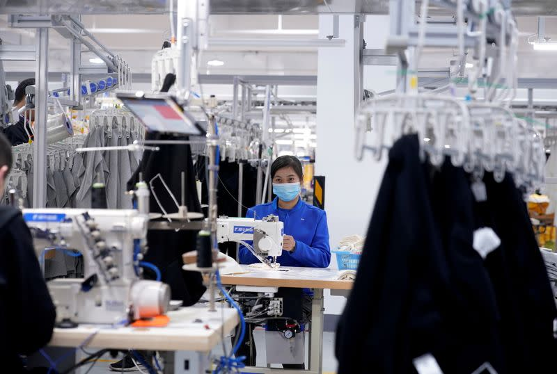 FILE PHOTO: A worker works at Xunxi factory, which is an affiliate of Chinese e-commerce giant Alibaba, during a media tour, in Hangzhou