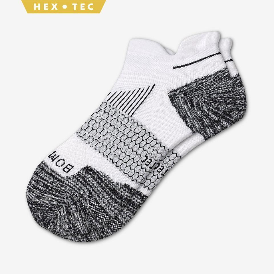 """<p><strong>Bombas</strong></p><p>bombas.com</p><p><strong>$16.00</strong></p><p><a href=""""https://bombas.com/products/womens-performance-running-ankle-sock?variant=white"""" rel=""""nofollow noopener"""" target=""""_blank"""" data-ylk=""""slk:Shop Now"""" class=""""link rapid-noclick-resp"""">Shop Now</a></p><p>Whoever said socks are a lame gift clearly never tried Bombas. These high-performance socks are made with hex construction, to optimize breathability in the most common hot spots. Plus, the signature tab on the back will keep blisters at bay. What's more, for every pair of socks purchased, Bombas donates a pair to homeless shelters. </p>"""