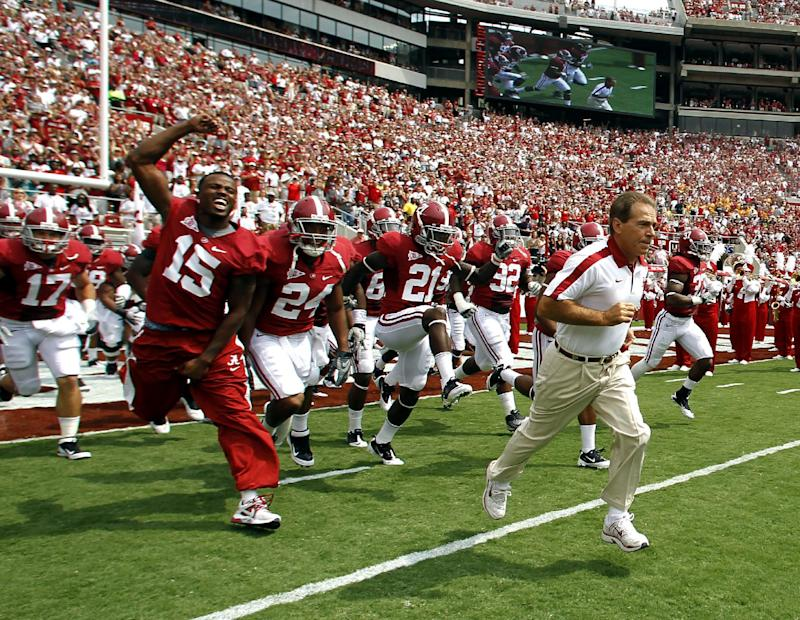 Alabama coach Nick Saban, right, leads the team onto the field for an NCAA college football game against Kent State, Saturday, Sept. 3, 2011 in Tuscaloosa, Ala.  (AP Photo/Butch Dill)