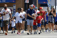 FILE - In this June 11, 2021, file photo, people cross a street as they make their way toward Chicago's Wrigley Field for a baseball game. COVID-19 deaths in the U.S. have dipped below 300 a day for the first time since the early days of the disaster in March 2020, while the number of Americans fully vaccinated has reached about 150 million. (AP Photo/Shafkat Anowar, File)