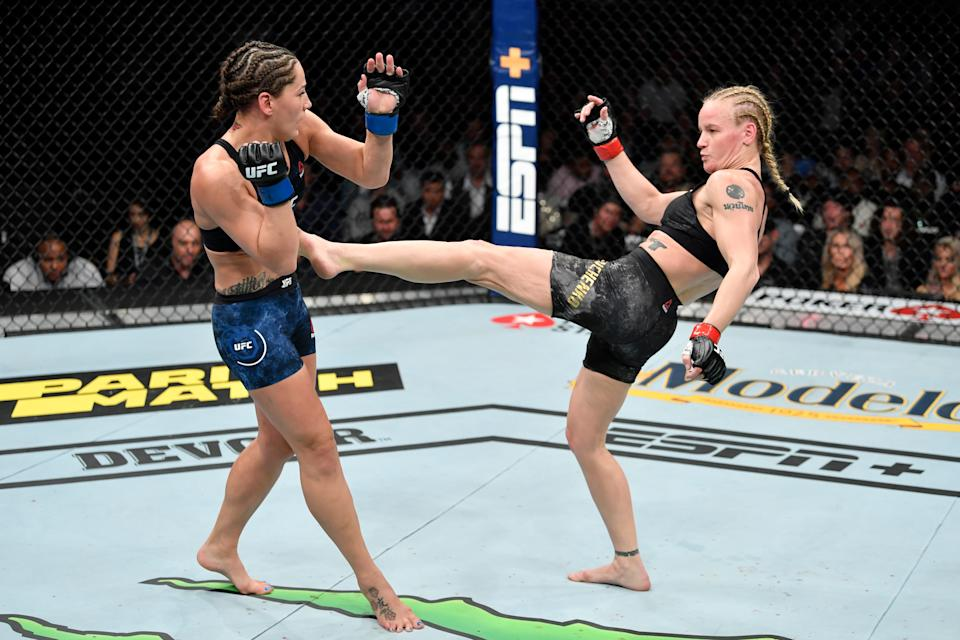 CHICAGO, IL - JUNE 08:  (R-L) Valentina Shevchenko of Kyrgyzstan kicks Jessica Eye in their women's flyweight championship bout during the UFC 238 event at the United Center on June 8, 2019 in Chicago, Illinois. (Photo by Jeff Bottari/Zuffa LLC/Zuffa LLC via Getty Images)