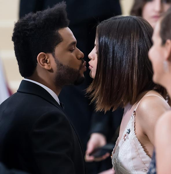 Selena Gomez and The Weekend made their relationship official at the 2017 Met Gala, posing for several adorable couple photos.