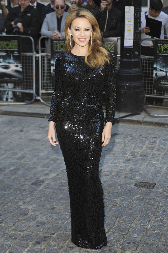 "Also spotted looking lovely in black this week was Aussie pop tart, Kylie Minogue, who oozed glamour at the U.K. debut of <a target=""_blank"" href=""http://movies.yahoo.com/movie/holy-motors/"">""Holy Motors""</a> in a long-sleeve, sequined Dolce & Gabbana gown and dripping diamond earrings, courtesy of De Beers. (9/18/2012)<br><br><a target=""_blank"" href=""http://omg.yahoo.com/blogs/jam/"">Jam: Spotlight on Music Stars<br></a>"