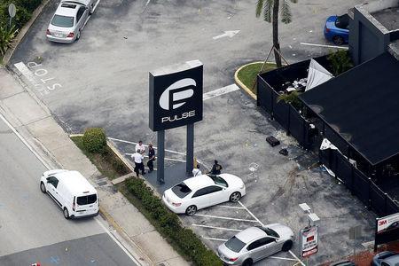 FILE PHOTO: Investigators work the scene following a mass shooting at the Pulse gay nightclub in Orlando Florida, U.S. on June 12, 2016. REUTERS/Carlo Allegri/File Photo
