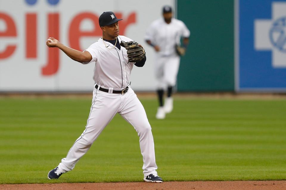 Tigers second baseman Jonathan Schoop makes a throw to first base for an out during the first inning against the Brewers on Tuesday, Sept. 8, 2020, at Comerica Park.