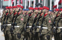 Polish soldiers stand at attention during ceremonies marking the centennial of the Battle of Warsaw, a Polish military victory in 2020 that stopped the Russian Bolshevik march toward the west, in Warsaw, Poland, Saturday, Aug. 15, 2020. Pompeo attended as he wrapped up a visit to central Europe. (AP Photo/Czarek Sokolowski)