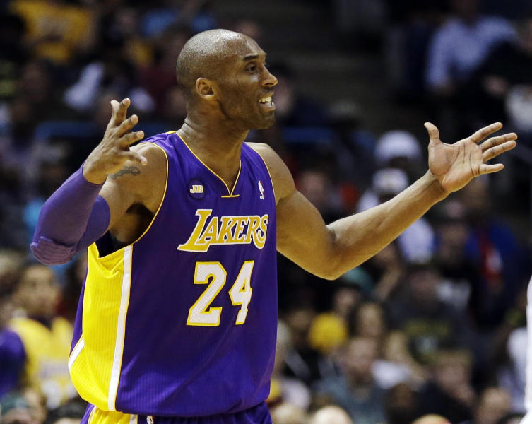 Los Angeles Lakers' Kobe Bryant argues a call against the Milwaukee Bucks during the second half of an NBA basketball game, Thursday, March 28, 2013, in Milwaukee. The Bucks won 113-103.(AP Photo/Jeffrey Phelps)
