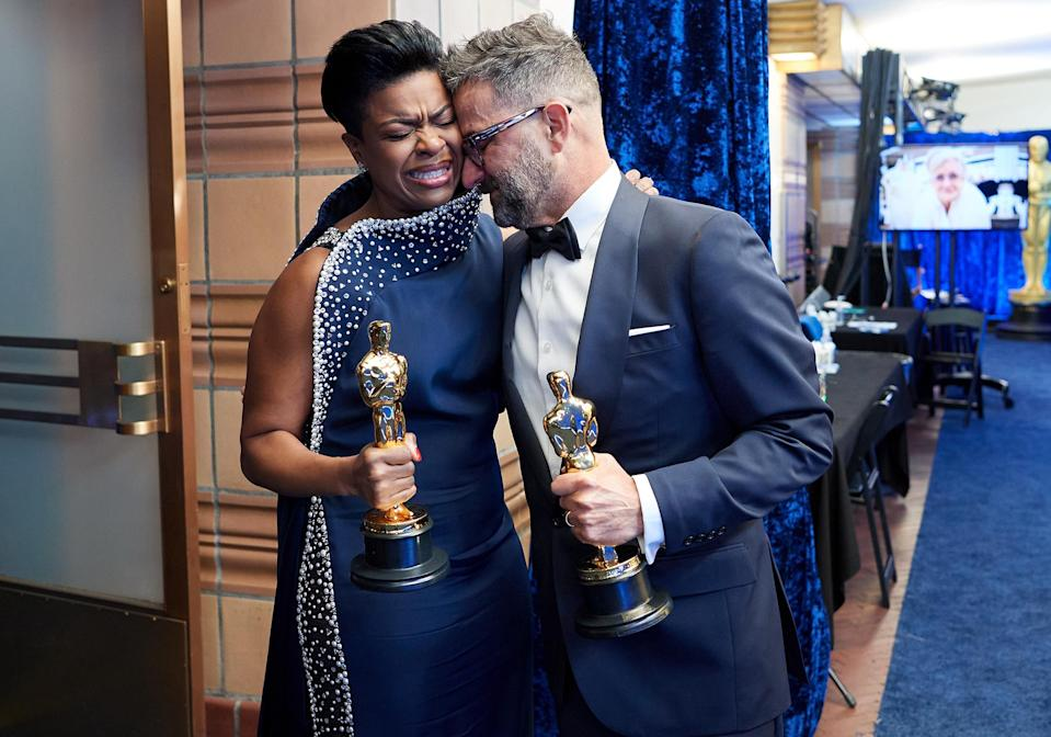 <p>Mia Neal has an emotional moment with colleague Sergio Lopez-Rivera after their win for Best Makeup and Hairstyling. Neal and collaborator Jamika Wilson became the first women to win Oscars in the category on Sunday night. </p>