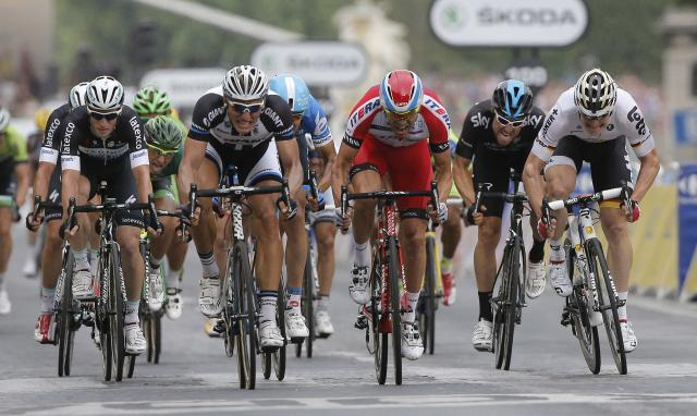 Germany's Marcel Kittel, second left, races to the finish line to win the twenty-first and last stage of the Tour de France cycling race over 137.5 kilometers (85.4 miles) with start in Evry and finish in Paris, France, Sunday, July 27, 2014. (AP Photo/Christophe Ena)