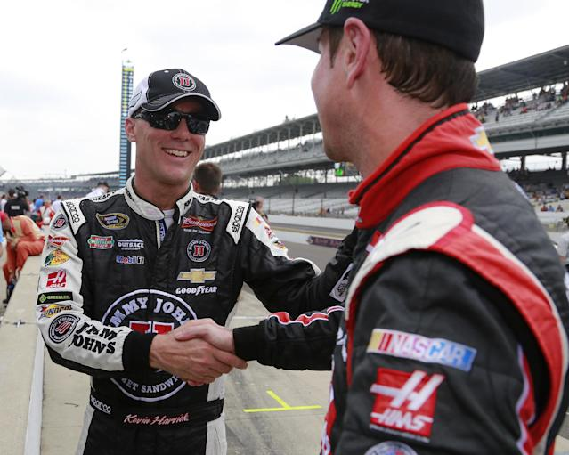 Kevin Harvick, left, is congratulated by Kurt Busch after winning the pole for the Brickyard 400 auto race at the Indianapolis Motor Speedway in Indianapolis, Saturday, July 26, 2014. (AP Photo/R Brent Smith)