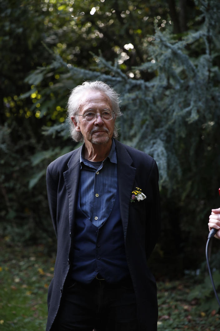 Austrian author Peter Handke poses for a photo at his house in Chaville near Paris, Thursday, Oct. 10, 2019. Handke was awarded the 2019 Nobel Prize in literature earlier Thursday. (AP Photo/Francois Mori)