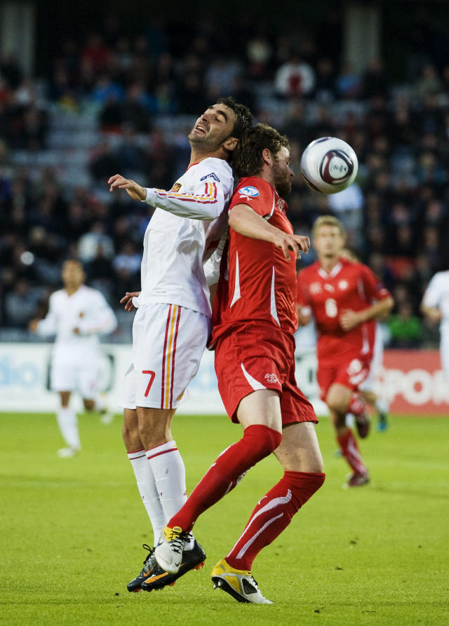 Swiss's Jonathan Rossini (R) jumps for the ball against with Spain's Adrian Lopez during the UEFA Under-21 European Championship final match Spain vs Switzerland at the Aarhus Stadium, on June 25, 2011. AFP PHOTO/JONATHAN NACKSTRAND (Photo credit should read JONATHAN NACKSTRAND/AFP/Getty Images)