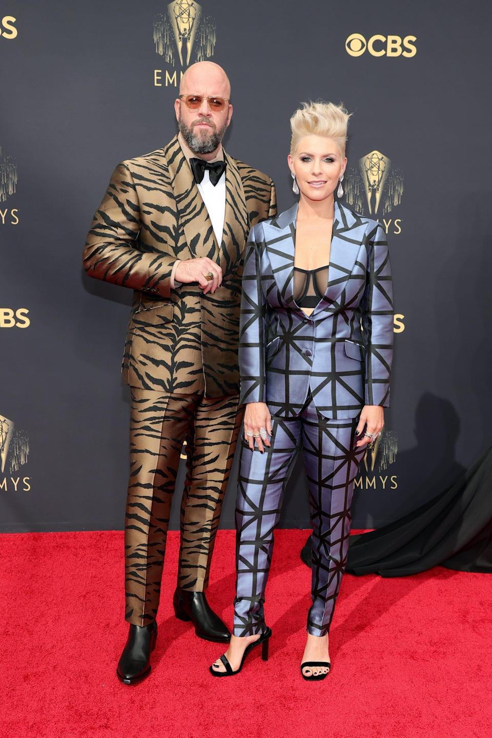 Chris and Rachel Sullivan wear animal print suits on the Emmys red carpet.