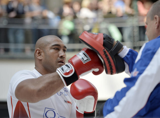 Challenger Alex Leapai from Australia-Samoa exercises during a public training ahead of his IBF, IBO, WBO and WBA heavyweight title bout against World boxing champion Wladimir Klitschko of Ukraine in Oberhausen, Germany, Wednesday, April 23, 2014. (AP Photo/Martin Meissner)