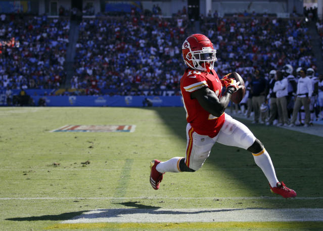 FILE - In this Sunday, Sept. 9, 2018, file photo, Kansas City Chiefs wide receiver Tyreek Hill scores a touchdown during an NFL football game against the Los Angeles Chargers in Carson, Calif. Chiefs wide receiver/punt returner Tyreek Hill scored twice in Los Angeles, including a 91-yard punt return for a score. The Chiefs face the Pittsburgh Steelers on Sunday. (AP Photo/Jae C. Hong, File)
