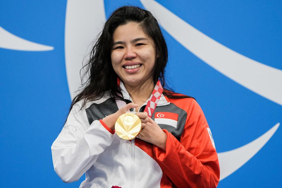 Singapore para-swimmer Yip Pin Xiu holding the gold medal she won on Wednesday (25 August) in the women's 100m backstroke (S2) event at the Tokyo Paralympics. (PHOTO: Sport Singapore)