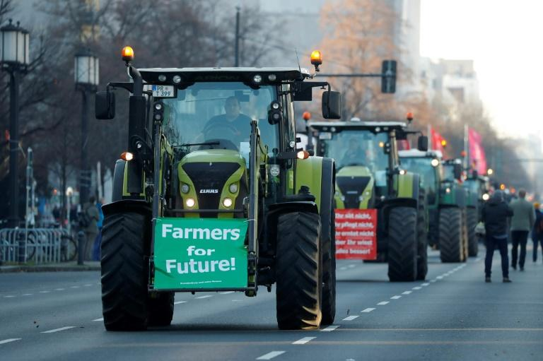 Thousands of tractors descended on cities across Germany on Friday at the opening of Berlin's annual 'Green Week' trade fair (AFP Photo/Odd ANDERSEN)