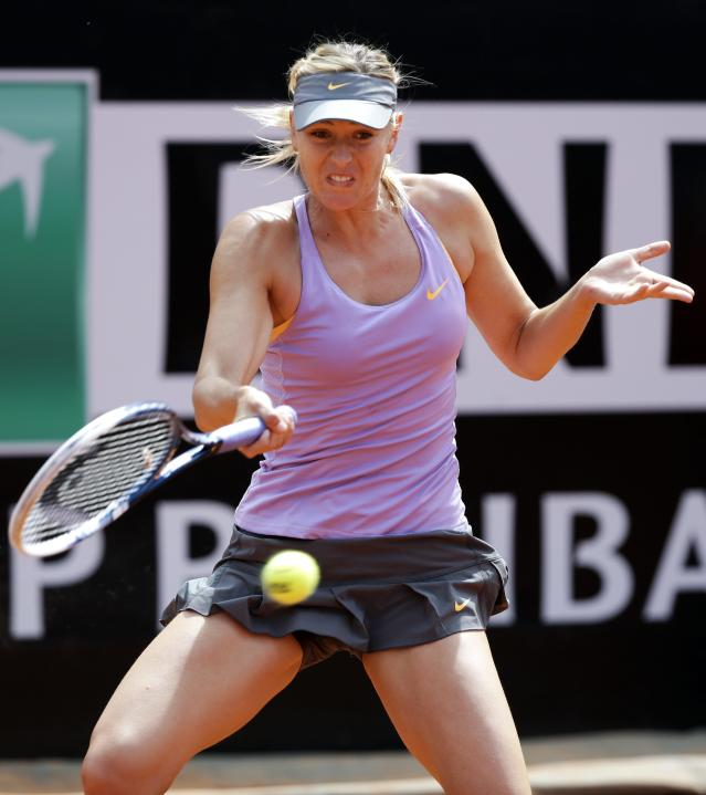Sharapova of Russia hits a return to Ivanovic of Serbia during their women's singles match at the Rome Masters tennis tournament