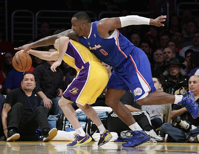 Los Angeles Clippers' Glen Davis, right, and Los Angeles Lakers' Jordan Farmar fight for a loose ball during the first half of an NBA basketball game on Thursday, March 6, 2014, in Los Angeles. (AP Photo/Jae C. Hong)