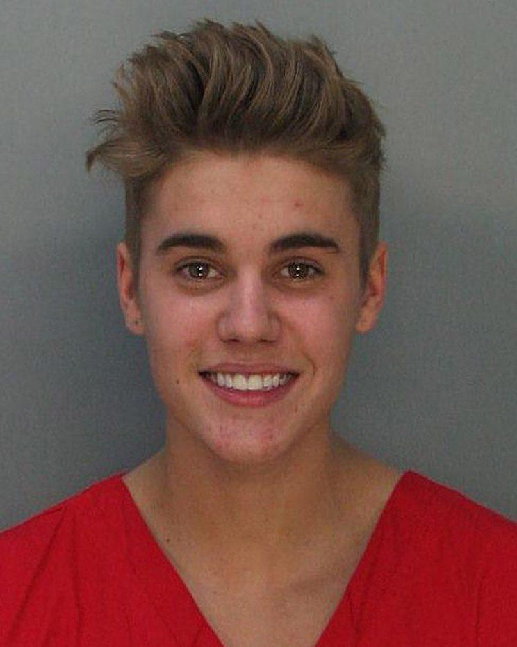 Justin Bieber says getting arrested isn't cool -- though he sure didn't look upset about it when it happened here in 2014. (Photo: Getty Images)