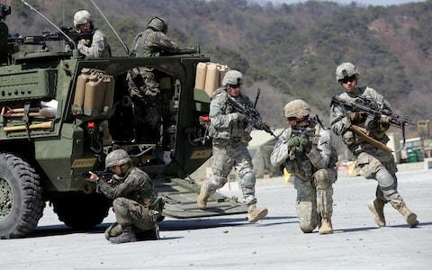 <span>The Pentagon says the annual US-South Korean military exercises that had been postponed for the Pyeongchang Winter Olympics will begin April 1</span> <span>Credit:  Lee Jin-man/AP </span>