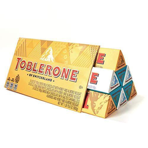 """<p><strong>Toblerone</strong></p><p>amazon.com</p><p><strong>$21.98</strong></p><p><a href=""""https://www.amazon.com/dp/B08J37H3QK?tag=syn-yahoo-20&ascsubtag=%5Bartid%7C1782.g.994%5Bsrc%7Cyahoo-us"""" rel=""""nofollow noopener"""" target=""""_blank"""" data-ylk=""""slk:BUY NOW"""" class=""""link rapid-noclick-resp"""">BUY NOW</a></p><p>You already know and love Toblerone's nougat chocolates, but this set includes milk chocolate, white chocolate, and crunchy salted caramelized almond.<br></p>"""