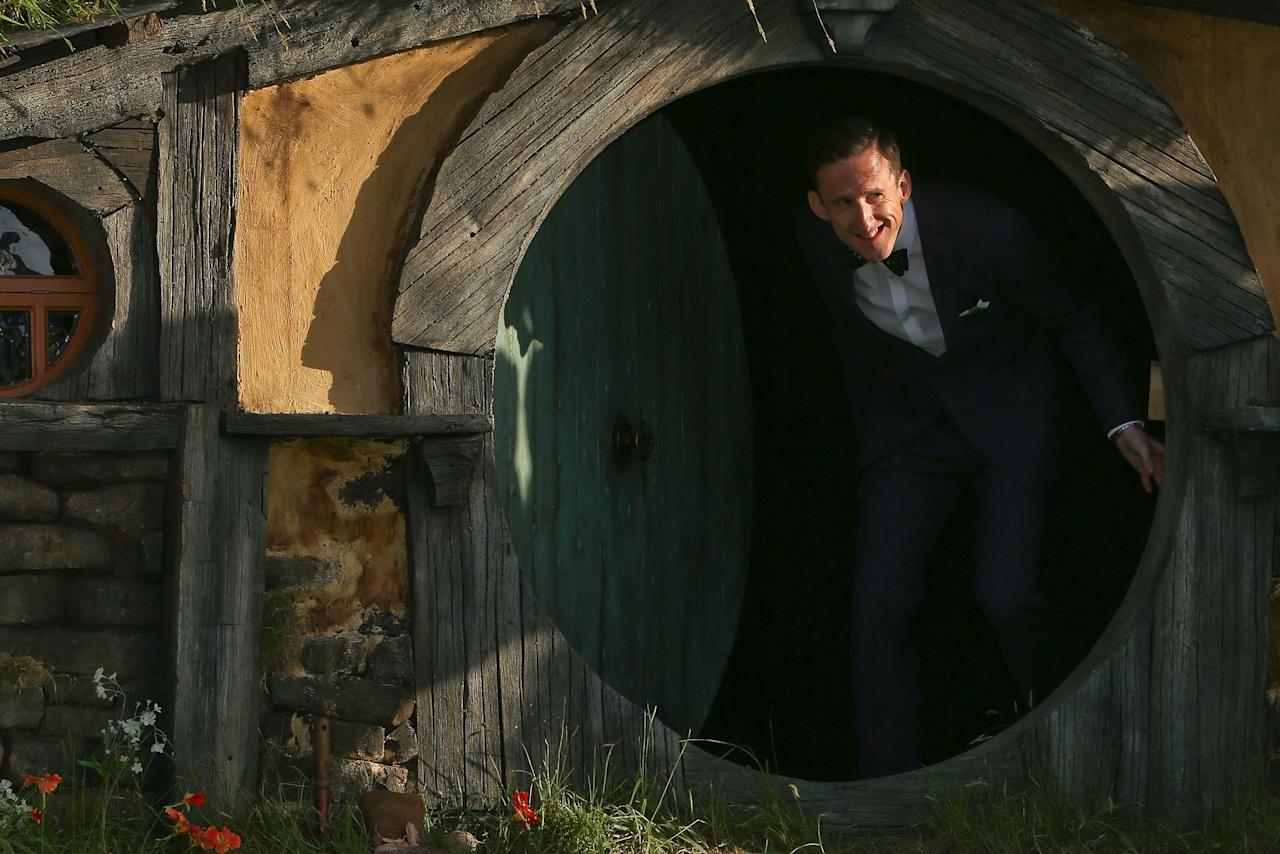 "WELLINGTON, NEW ZEALAND - NOVEMBER 28:  Adam Brown who plays Ori, emerges from a Hobbit house at the ""The Hobbit: An Unexpected Journey"" World Premiere at Embassy Theatre on November 28, 2012 in Wellington, New Zealand.  (Photo by Hagen Hopkins/Getty Images)"