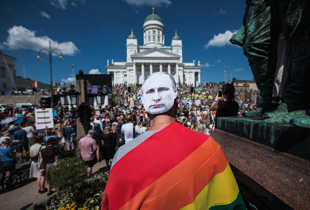 "<p>A protester wears a mask bearing a portrait of Russian President Vladimir Putin as protesters gather on the Senate Square at the end of the so-called ""Helsinki Calling"" march to defend the human rights, freedom of speech and democracy on July 15, 2018, ahead of the arrival of President for a summit with his Russian counterpart in the Finnish capital Helsinki. (Photo: Jonathan Nackstrand/AFP/Getty Images) </p>"