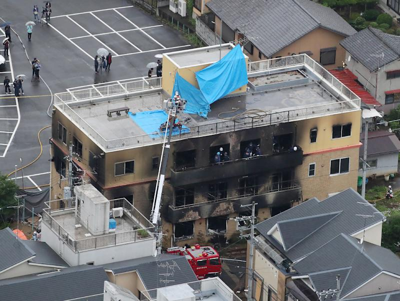 This aerial view shows the rescue and recover scene after the fire (Photo by JIJI PRESS / JIJI PRESS / AFP)