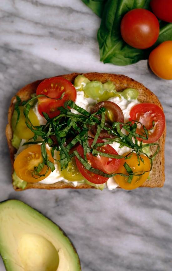 """<p><strong>Get the recipe:</strong> <a href=""""https://www.popsugar.com/food/Avocado-Toast-Recipes-Video-36701287"""" class=""""ga-track"""" data-ga-category=""""Related"""" data-ga-label=""""http://www.popsugar.com/food/Avocado-Toast-Recipes-Video-36701287"""" data-ga-action=""""In-Line Links"""">avocado toast with heirloom tomatoes, burrata, and basil</a>.</p>"""