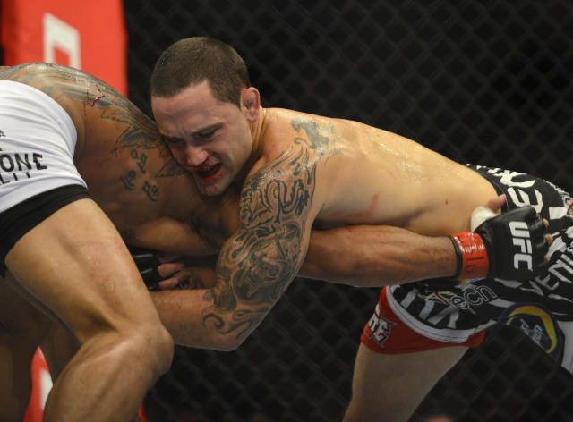 A bloodied Frankie Edgar from New Jersey fights with Benson Henderson from Arizona in their middleweight title bout during UFC 150 in Denver, Saturday, Aug. 11, 2012. Henderson won the bout. (AP Photo/Jack Dempsey)