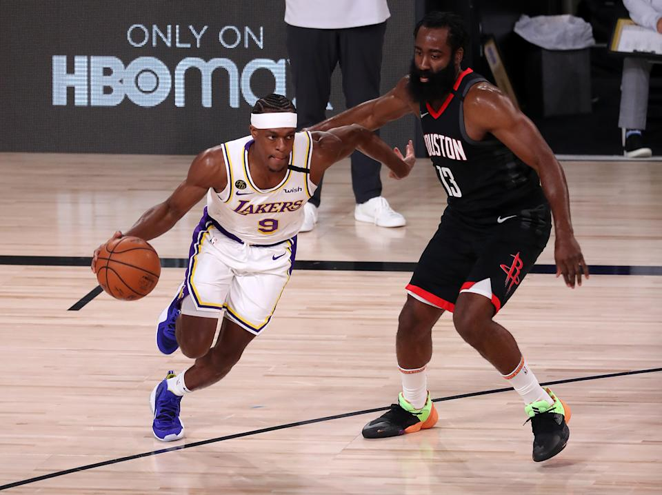 LAKE BUENA VISTA, FLORIDA - SEPTEMBER 08: Rajon Rondo #9 of the Los Angeles Lakers drives the ball against James Harden #13 of the Houston Rockets during the first quarter  in Game Three of the Western Conference Second Round during the 2020 NBA Playoffs at AdventHealth Arena at the ESPN Wide World Of Sports Complex on September 08, 2020 in Lake Buena Vista, Florida. NOTE TO USER: User expressly acknowledges and agrees that, by downloading and or using this photograph, User is consenting to the terms and conditions of the Getty Images License Agreement.  (Photo by Mike Ehrmann/Getty Images)