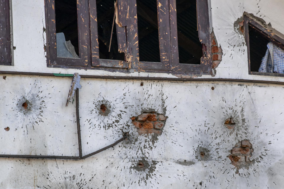 Bullet marks cover the wall of the building where suspected militants had taken refuge on the outskirts of Srinagar, Indian controlled Kashmir, Wednesday, Dec. 30, 2020. A gun battle between rebels and government forces overnight killed three rebels on the outskirts of Srinagar on Wednesday, officials said. (AP Photo/ Dar Yasin)
