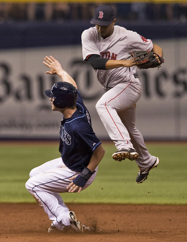 Boston Red Sox shortstop Xander Bogaerts, right, leaps over Tampa Bay Rays' Wil Myers after forcing him out at second base during the fifth inning of a baseball game Sunday, May 25, 2014 in St. Petersburg, Fla. (AP Photo/Steve Nesius)