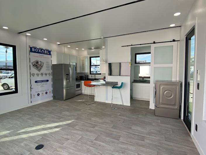 the kitchen and bathroom inside an example Casita