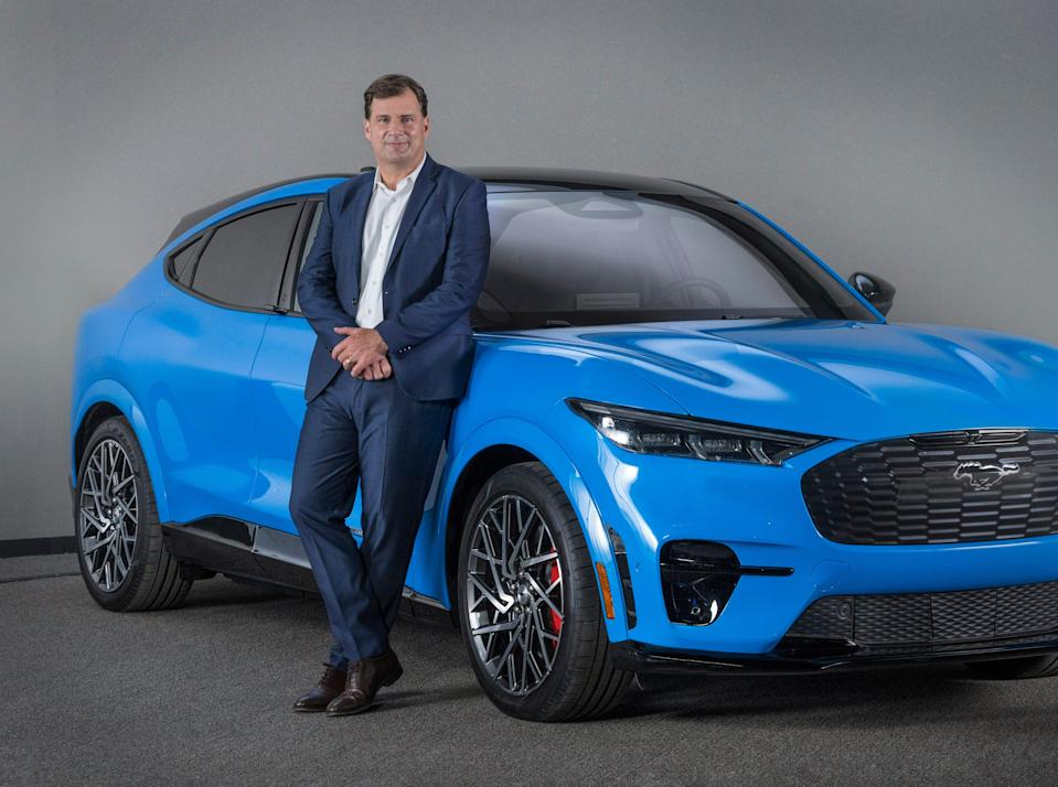 Ford CEO Jim Farley is standing with the 2021 all-electric Mustang Mach-E in Dearborn in September. This photo was taken during a video shoot to support the introduction of Mustang Mach-E in China at the 2020 Beijing Auto Show.