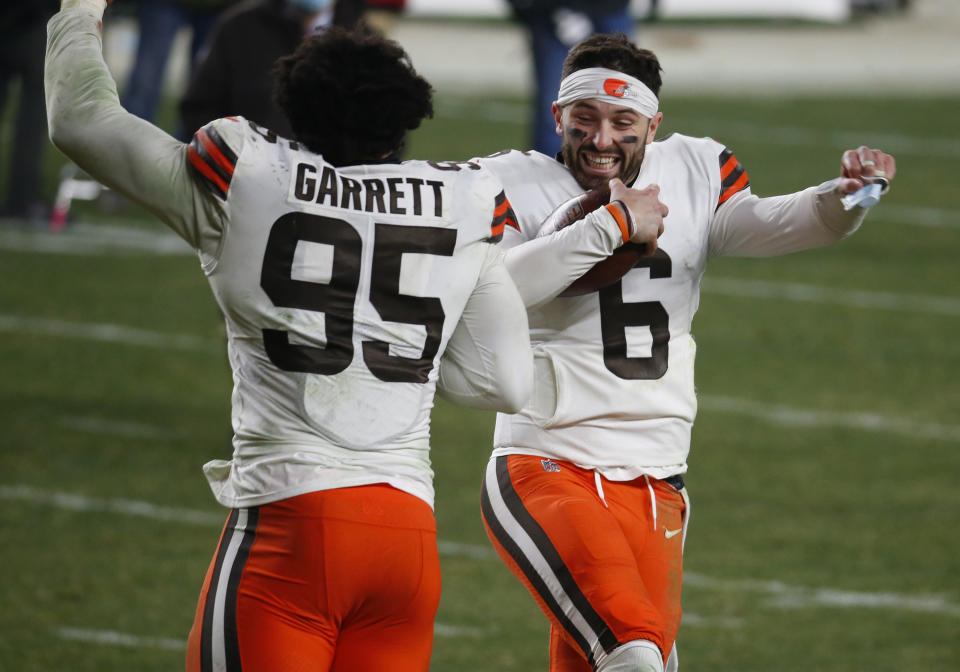 Baker Mayfield #6 of the Cleveland Browns and Myles Garrett #95 of the Cleveland Browns celebrate against the Pittsburgh Steelers on January 11, 2021 at Heinz Field in Pittsburgh, Pennsylvania.  (Photo by Justin K. Aller/Getty Images)