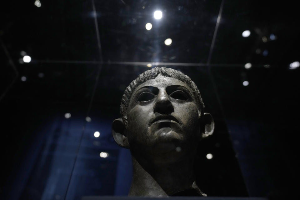 """A bronze head of Roman emperor Nero dating from around AD 54-61 and found in the River Alde at Rendham in Suffolk, eastern England, is displayed during a media preview for the """"Nero: the man behind the myth"""" exhibition, at the British Museum in London, Monday, May 24, 2021. The exhibition, which opens to visitors on May 27 and runs until October 24, explores the true story of Rome's fifth emperor informed by new research and archaeological evidence from the time. (AP Photo/Matt Dunham)"""