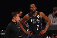 Brooklyn Nets forward Kevin Durant (7) talks with head coach Steve Nash during a break in play against the Boston Celtics in the first half of Game 5 during an NBA basketball first-round playoff series, Tuesday, June 1, 2021, in New York. (AP Photo/Adam Hunger)