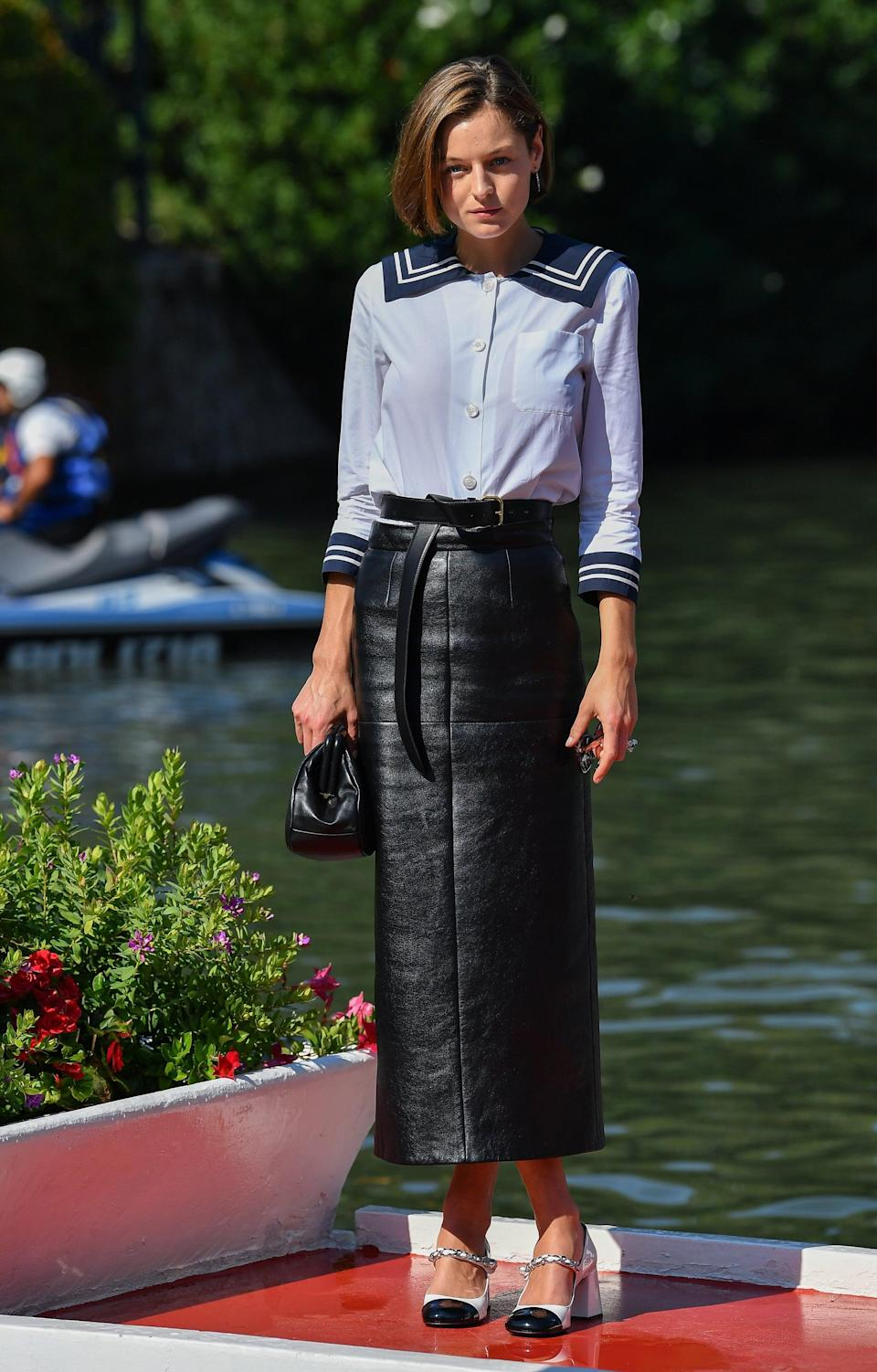 <p>Emma Corrin sure does love a statement collar - <strong>The Crown</strong> actor wore a classic sailor blouse and a black leather maxi skirt to the 2020 Venice Film Festival.</p>