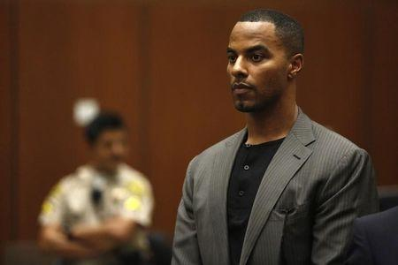 Former professional football player Darren Sharper appears for his arraignment at the Clara Shortridge Foltz Criminal Justice Center in Los Angeles, California February 20, 2014. REUTERS/Mario Anzuoni