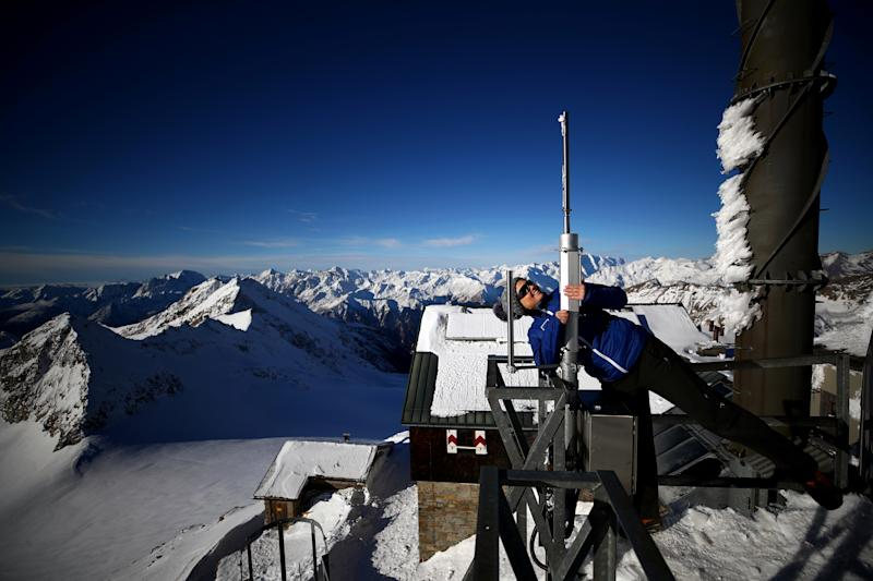 Meteorologist Elke Ludewig from the Central Institute for Meteorology and Geodynamics ZAMG, looks up an ice load scale at the Sonnblick Observatory at 3,106 meters above sea level, located in the Hohe Tauern mountain range near Rauris, Austria. (Photo: Lisi Niesner/Reuters)