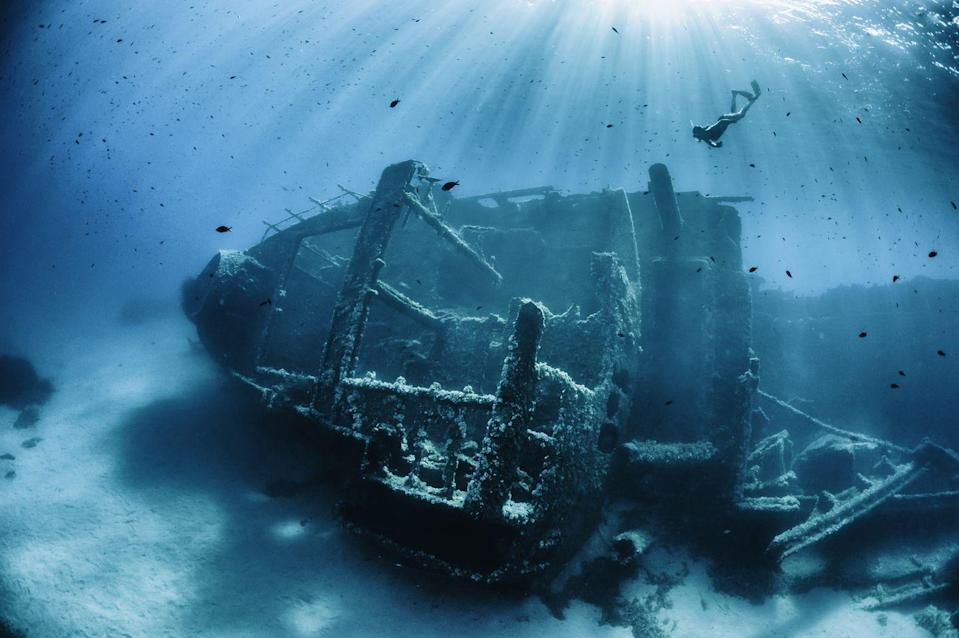 <p>Someone better call Disney because this stunning old shipwreck located on an undisclosed seabed looks like a set piece from <em>Pirates of the Caribbean</em>. </p>