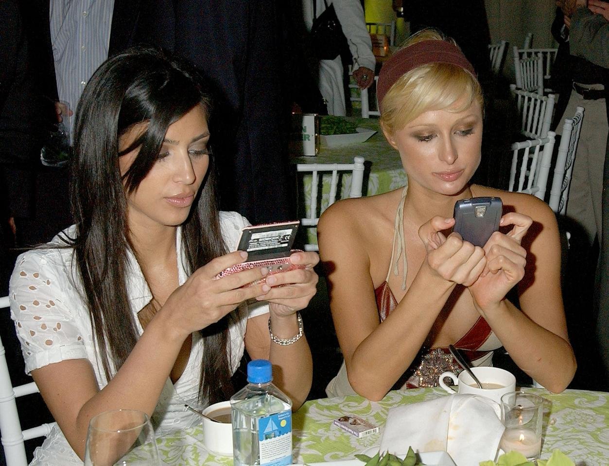 """<p>Kim and her BFF <a class=""""sugar-inline-link ga-track"""" title=""""Latest photos and news for Paris Hilton"""" href=""""https://www.popsugar.com/Paris-Hilton"""" target=""""_blank"""" data-ga-category=""""Related"""" data-ga-label=""""https://www.popsugar.com/Paris-Hilton"""" data-ga-action=""""&lt;-related-&gt; Links"""">Paris Hilton</a> were all texts, no talk at the LA premiere of <strong>Entourage</strong> in June 2006. </p>"""