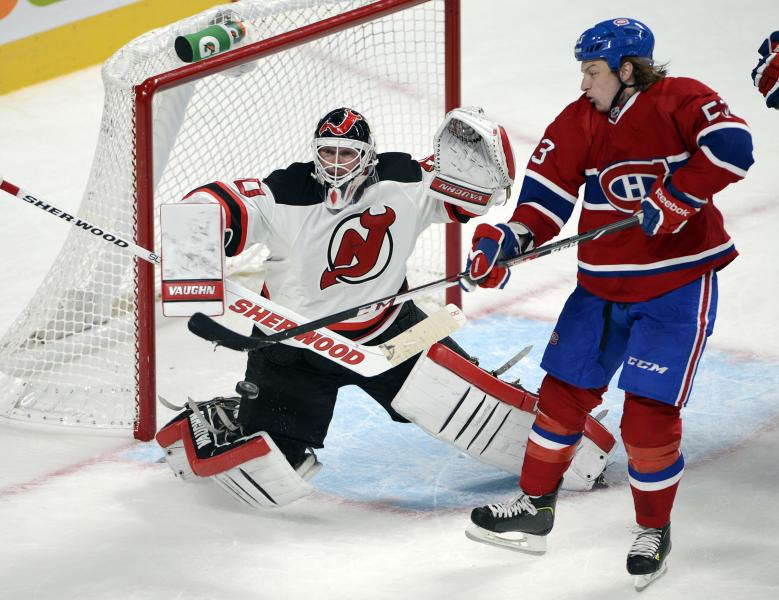 Montreal Canadiens' Ryan White deflects the puck past New Jersey Devils goaltender Martin Brodeur to score during the third period of an NHL hockey preseason game Monday, Sept. 23, 2013, in Montreal. The Canadiens won 3-2. (AP Photo/The Canadian Press, Ryan Remiorz)