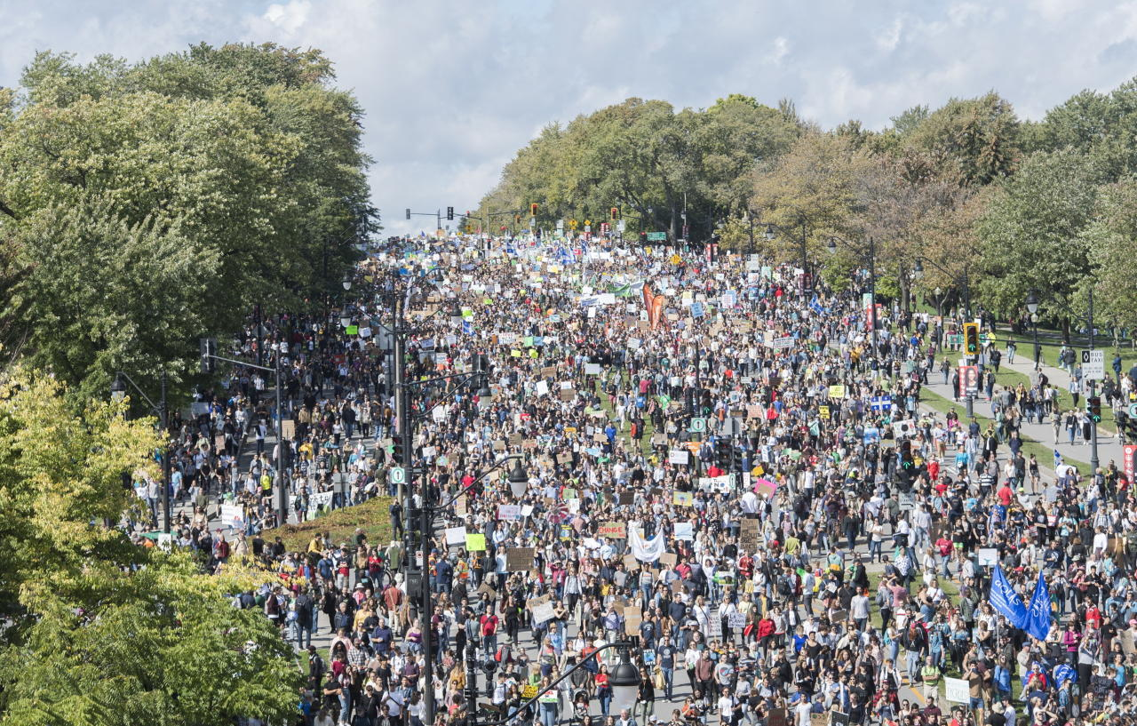 Demonstrators march during a climate strike in Montreal, Friday, Sept. 27, 2019. (Graham Hughes/The Canadian Press via AP)